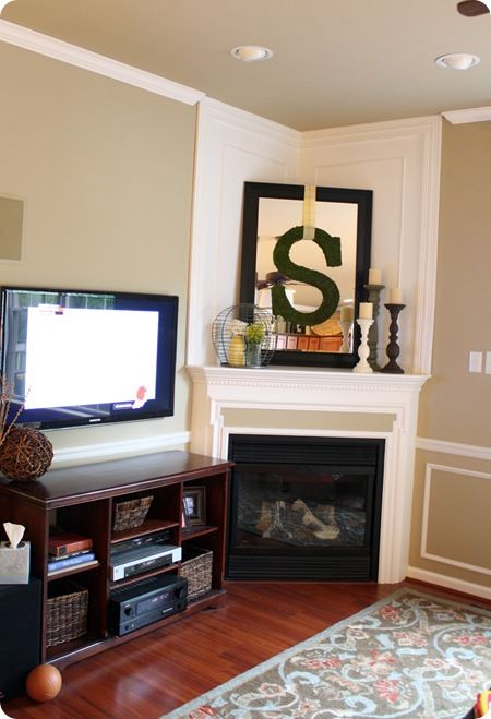 Such a great idea fill up the empty space over a mantle by putting a mirror and some color in for How to fill empty corner in living room
