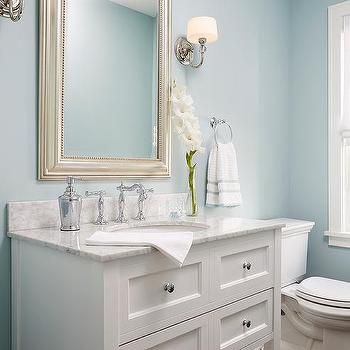 sky blue powder room walls with white single washstand