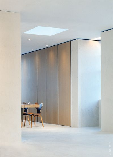 Floor To Ceiling Sleek Linear Cupboards In Soft Wood Finish