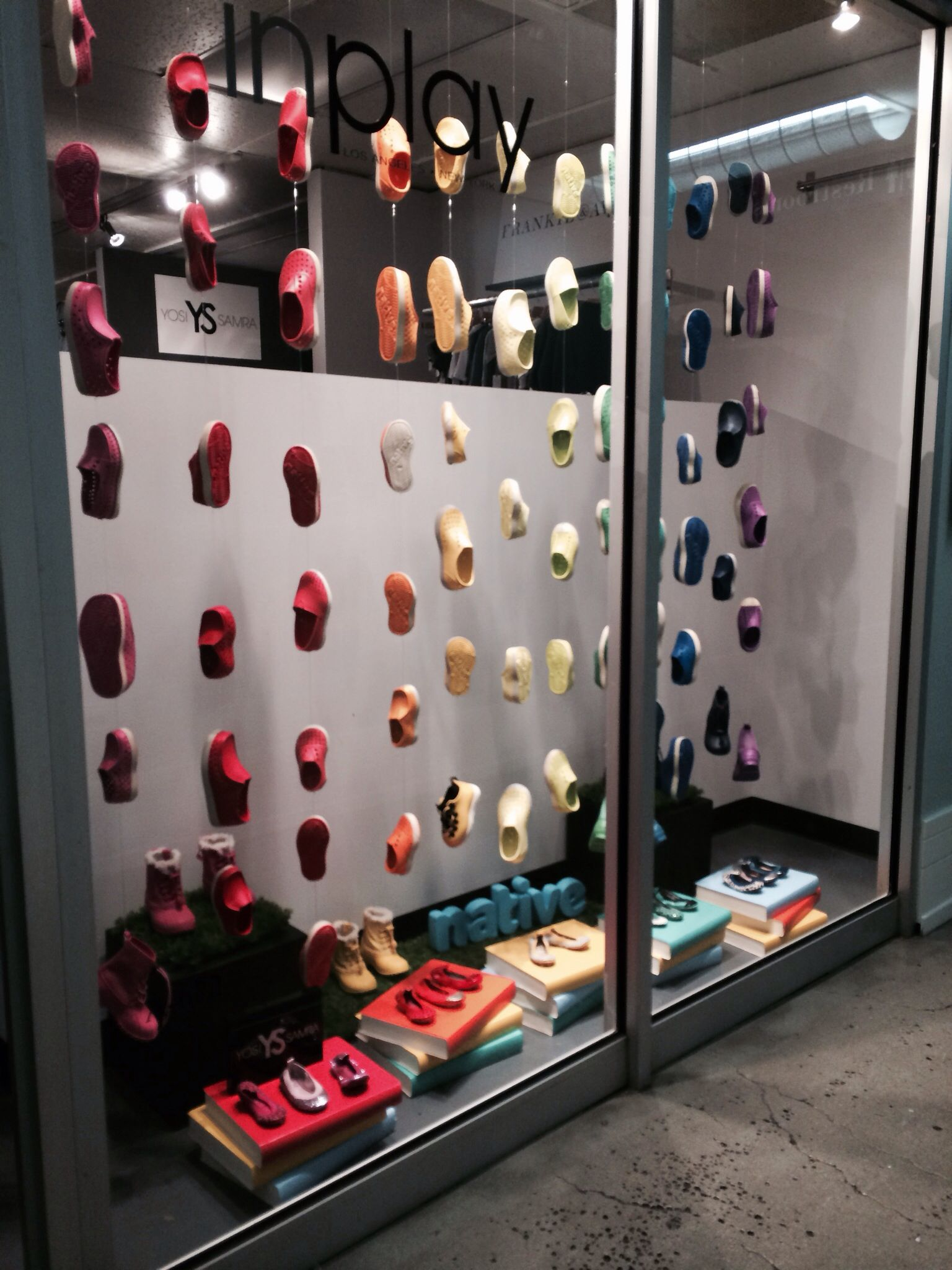 f2cdbe23013f Native shoes window display at in play showroom Los Angeles of rainbow  natives make such a feel good window. Keep it lite!