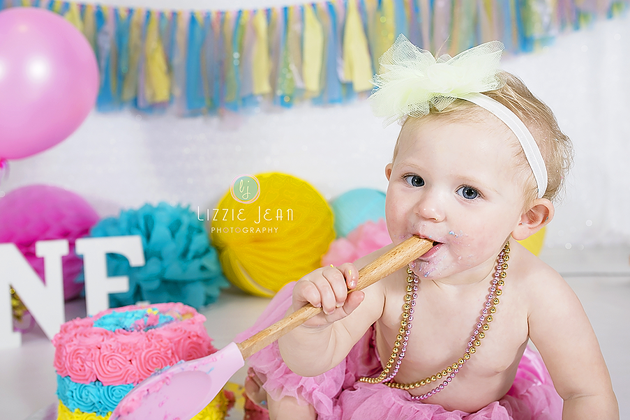 Girl cake smash pink blue yellow cake smash professional photographer melbourne photographer werribee newborn photography cheap photographer