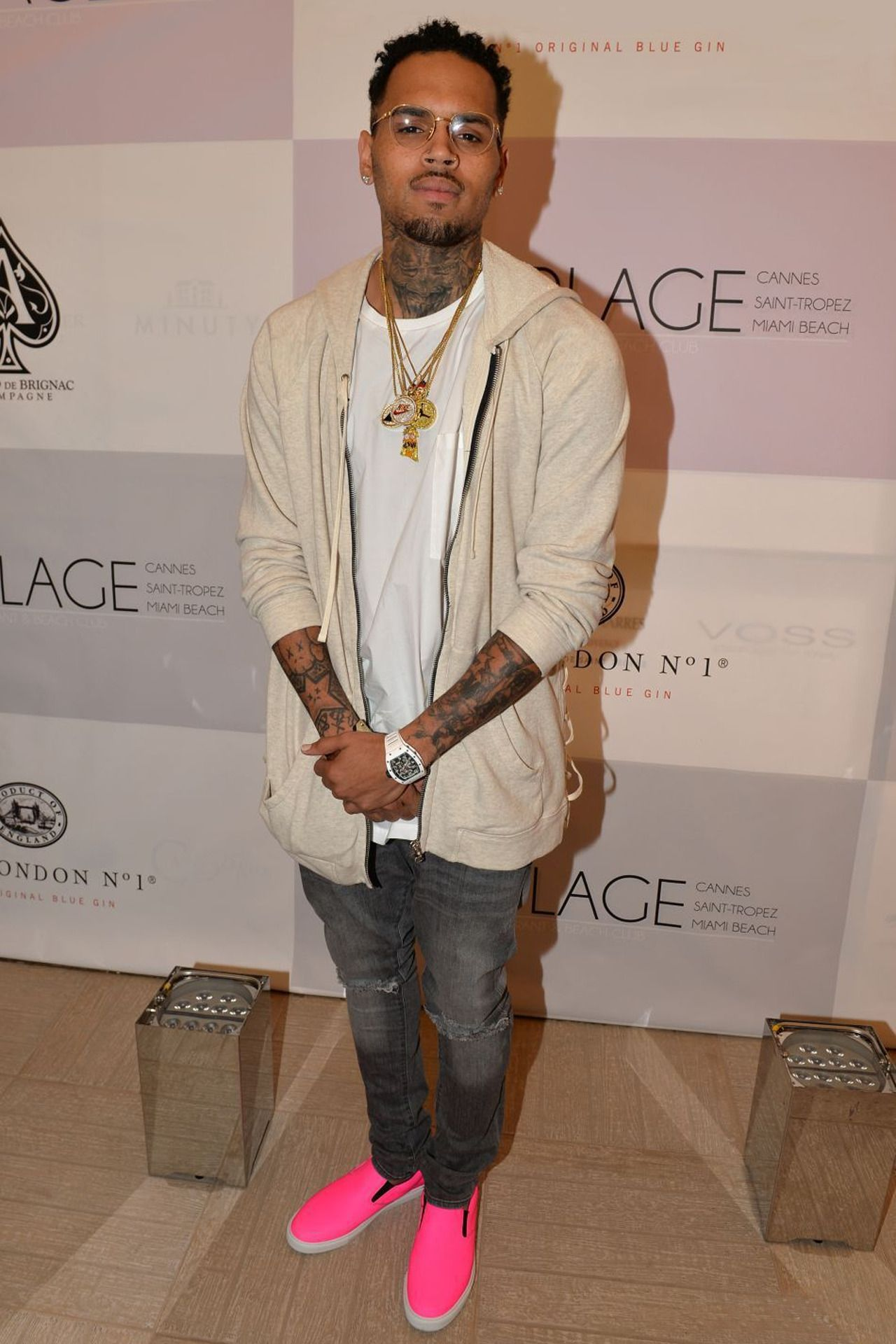 Chris Brown goes fashionably pinky shoes loud! Black