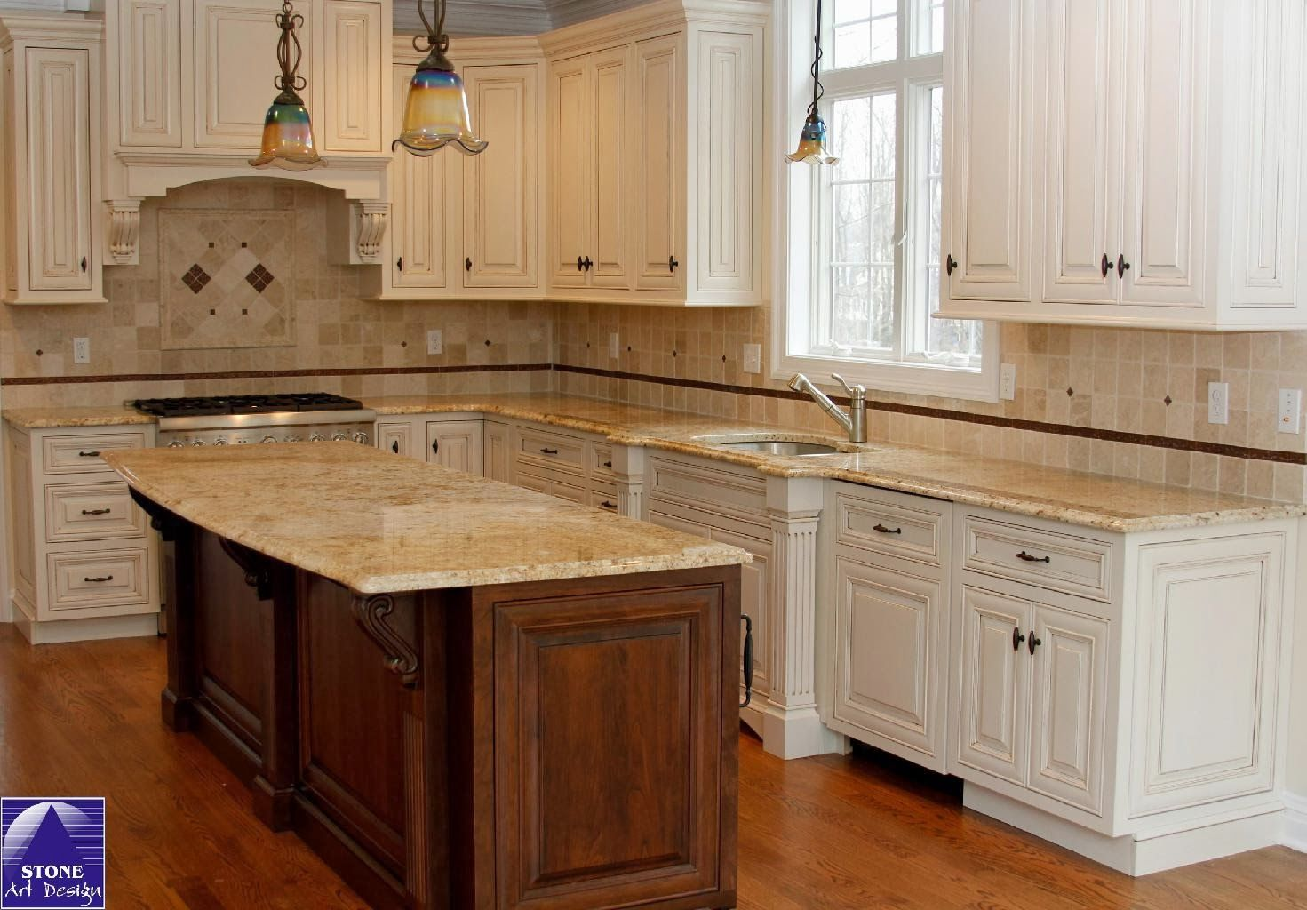 Kashmir Gold Slab Granite shown with a cream colored cabinet ...