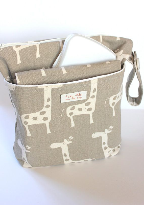 Wet bag with matching changing pad. There is a cute one that is gray with pink elephants, too.