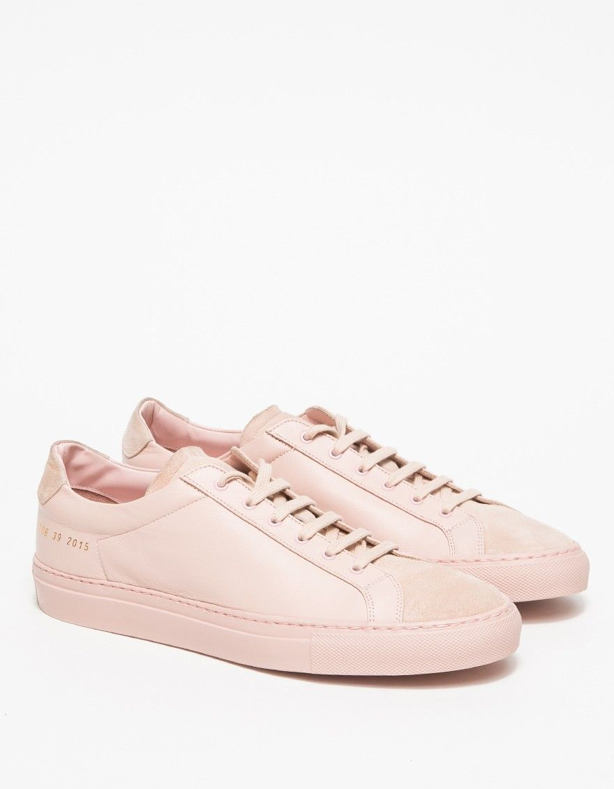 From Woman by Common Projects, a classic leather low top sneaker in blush.  Features