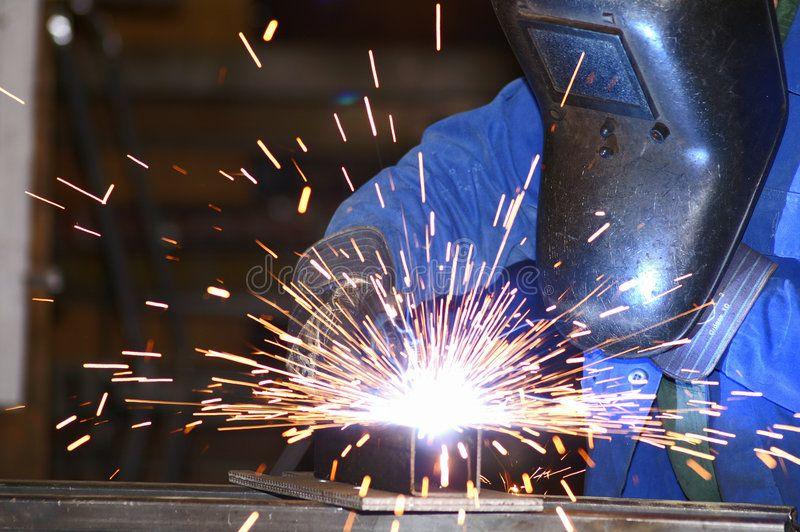 Welder 2 a worker is welding steel sponsored