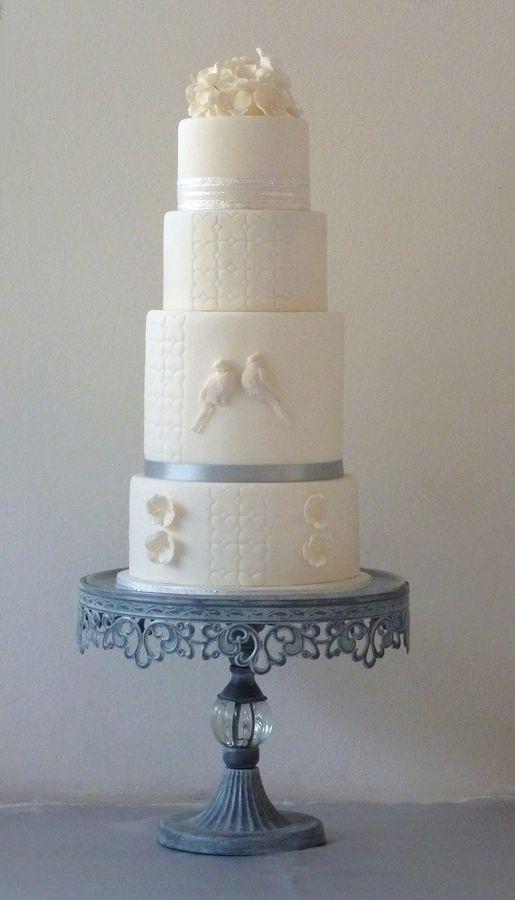 White wedding cake with lovebirds