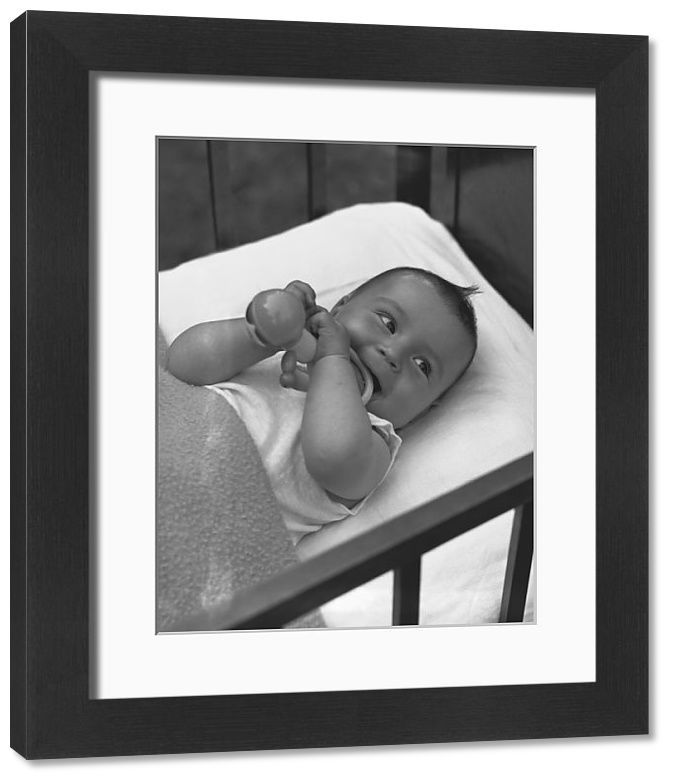 Print of Baby (3-6 months) lying in crib, (B&W), elevated view