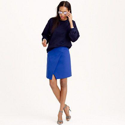 "With sleek, clean lines and an elevated faux front-wrap that easily dresses up or down, this is the mini skirt you could literally wear every day (that's why we made it in so many colors). <ul><li>Sits at waist.</li><li>19"" long.</li><li>Falls above knee.</li><li>Poly.</li><li>Back zip.</li><li>Lined.</li><li>Dry clean.</li><li>Import.</li></ul>"