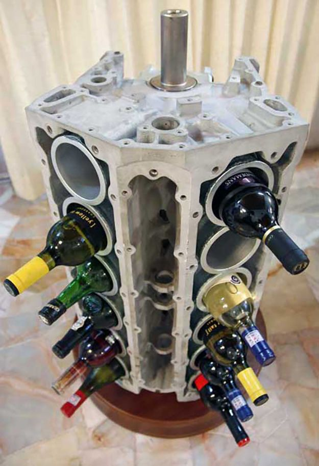 23 awesome diys made from old upcycled car parts diy for Arts and crafts wine rack