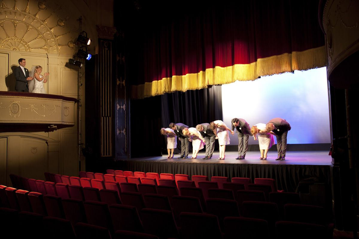 Wedding Photography at The Athenaeum Theater bridal party takes a bow