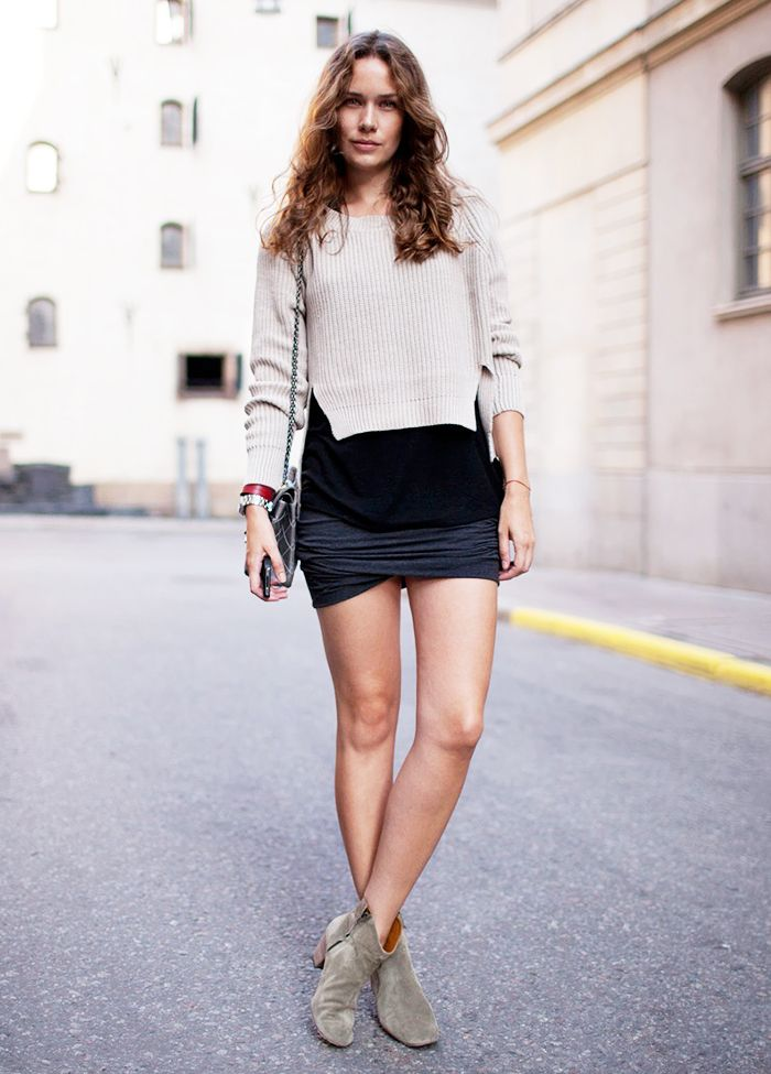 6e15542bf49 Gray mini skirt worn with a cable knit sweater and tan suede ankle boots