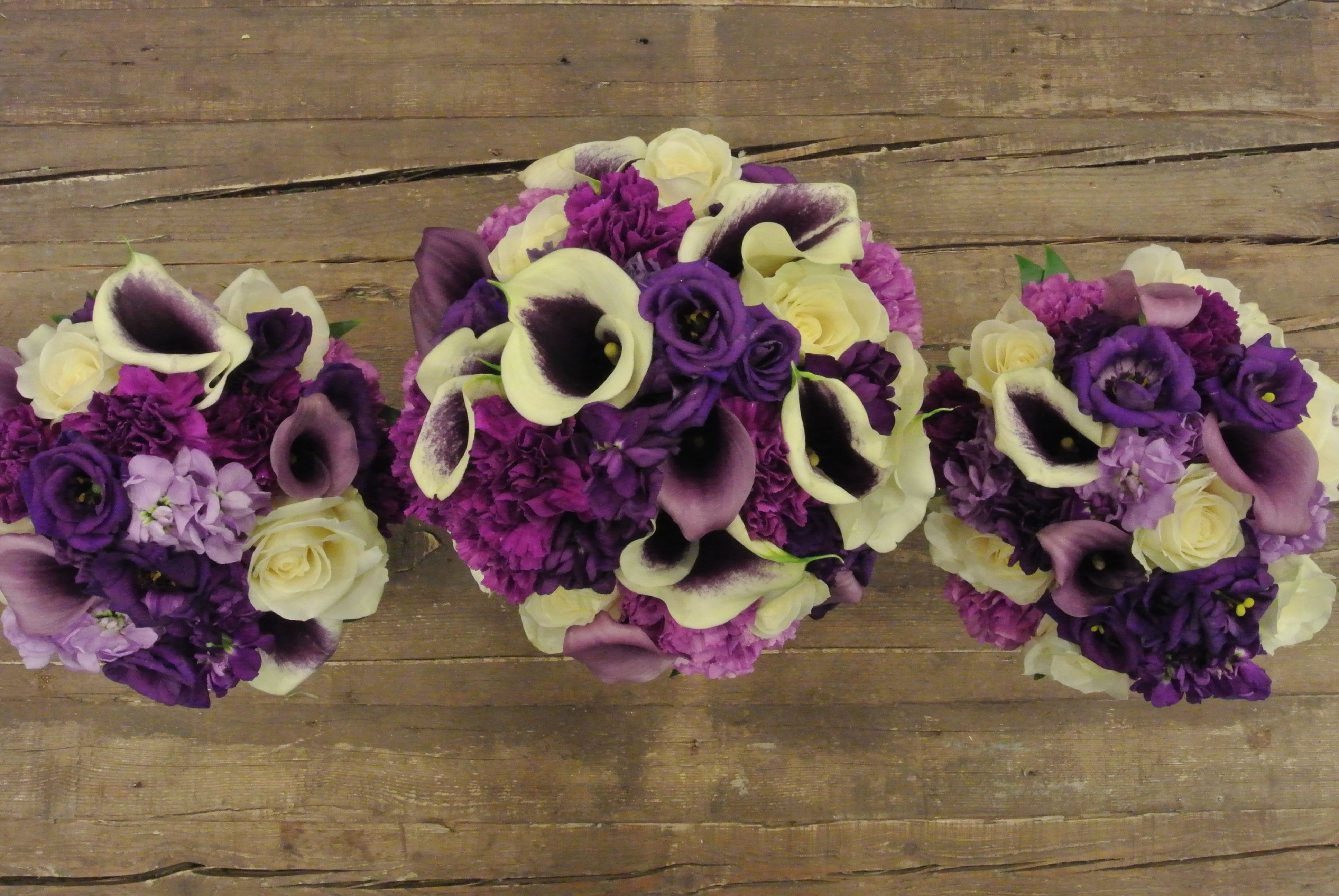 Purple bridal bouquets with picaso calla lilies carnations stocks purple bridal bouquets with picaso calla lilies carnations stocks lisianthus and roses designed by forget me not flowers izmirmasajfo
