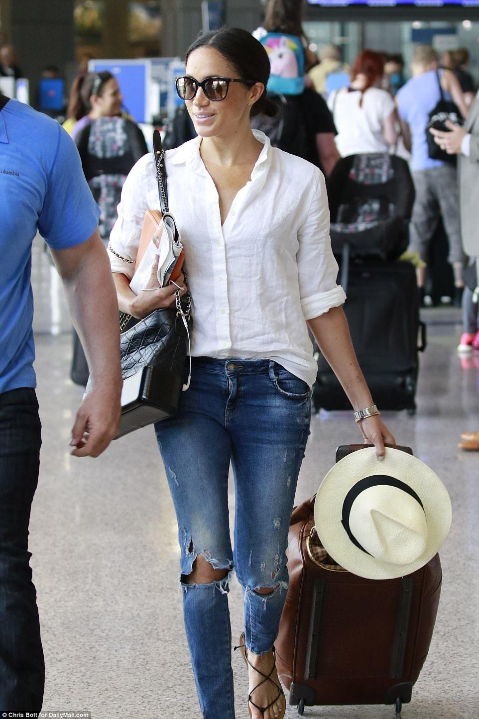 a41ac1246 Meghan Markle.. J. Crew shirt, Zara jeans, J. Crew sandals and sunglasses,  Chanel Gabrielle handbag, Madewell panama hat, Jennifer Meyer 18k white  gold ...
