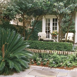 Classic Courtyards | Colorfully Accented Courtyard | SouthernLiving.com