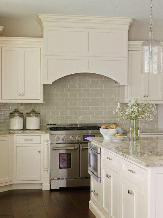 Gray Subway Tile Backsplash Under Ivory Cabinets And Curved Kitchen Hood Gl Jug Hanging Pendant Light Above Island Bria Hammel