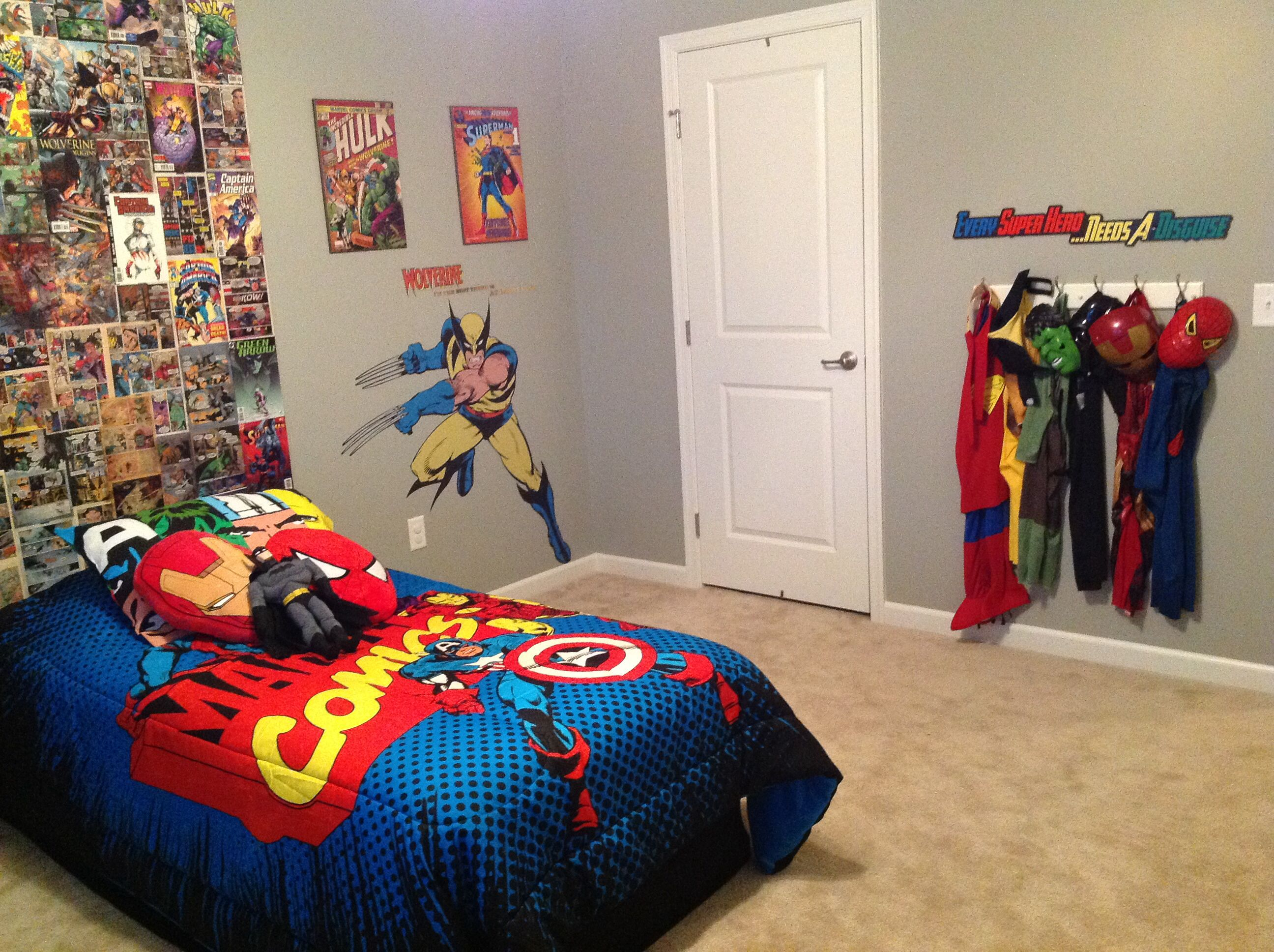 my sons super hero bedroom homemade backboard from comic books i found at a yard