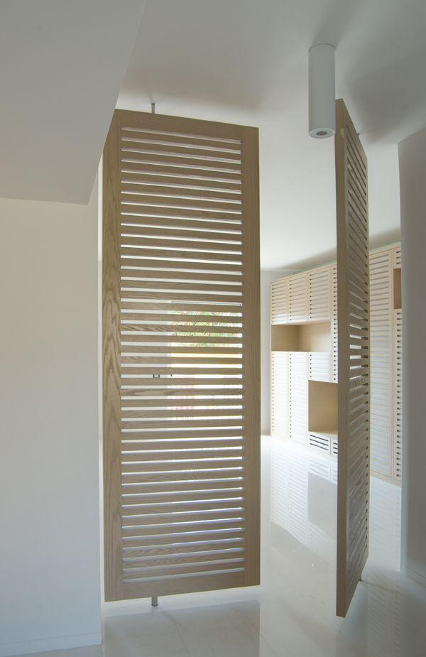 Louvred Pivot Doors Smn Studio Di Architettura G L Sylos Labini E Partners Casa V