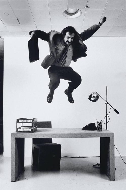 architect Frank Gehry demonstrates the durability of his compressed cardboard desk photo by Ralph Morse, 1972