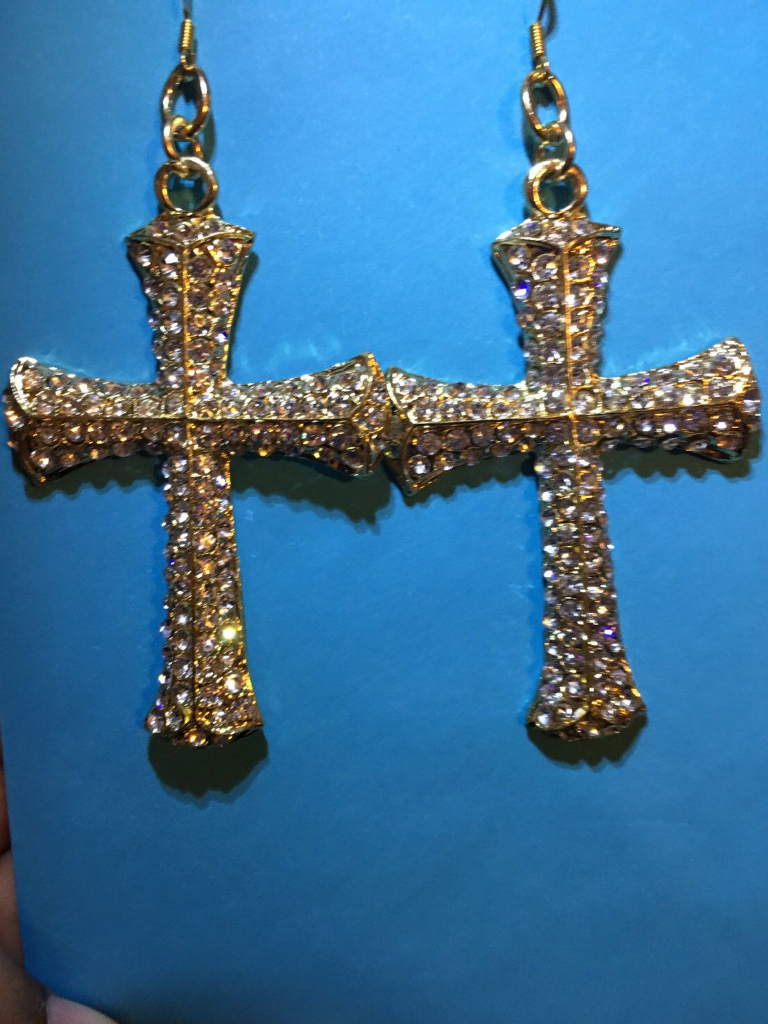 A personal favorite from my Etsy shop https://www.etsy.com/listing/504246175/gold-and-rhinestone-cross-crucifix-j4