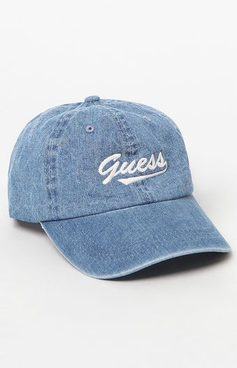 b1e73ab0396ba Keep cute and casual with this trendy dad hat from Guess. The Denim Guess  Dad