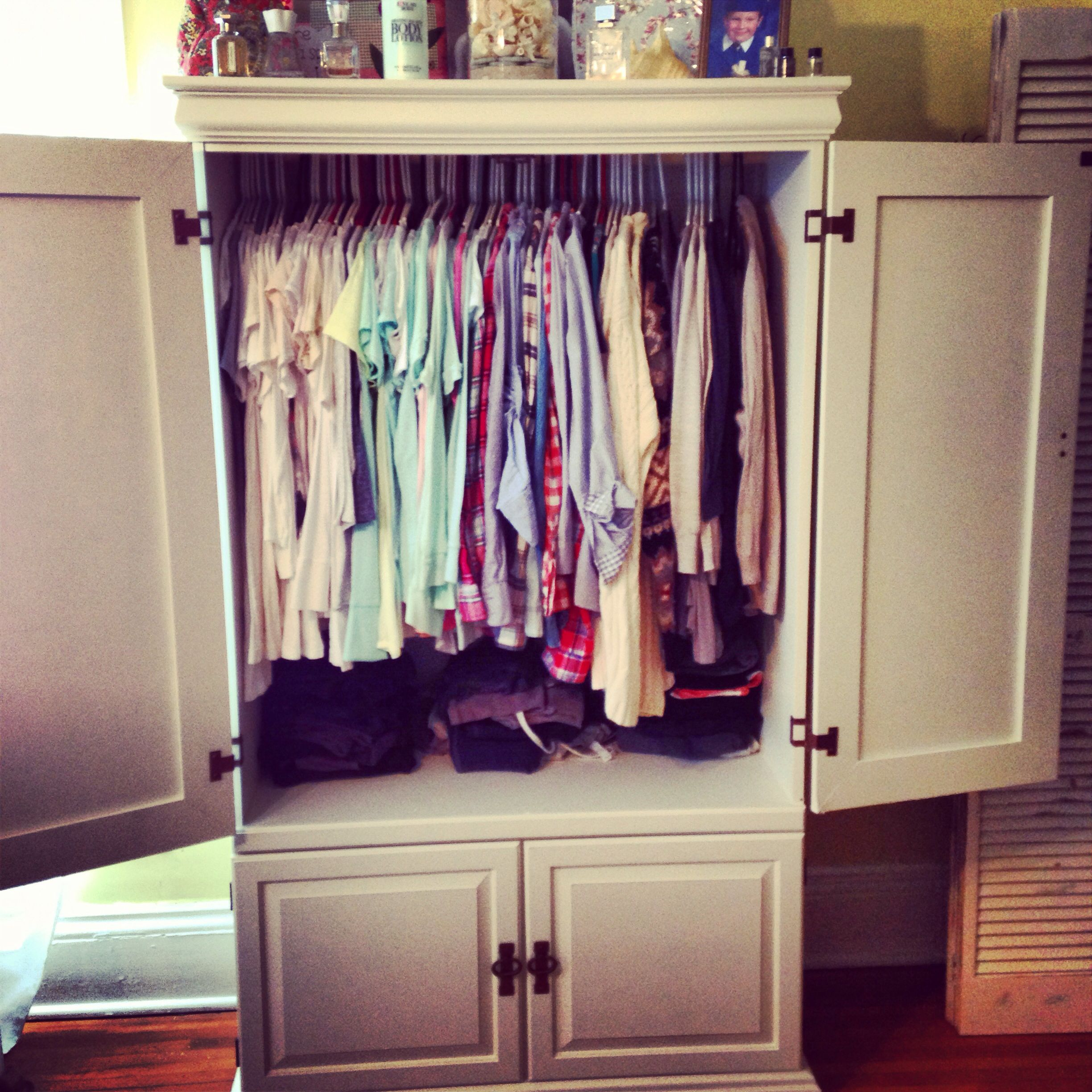 Re Purposed An Old Entertainment Center Into A Clothes Armoire.