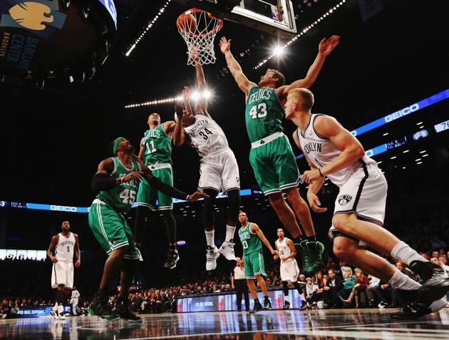 NEW YORK, NY - DECEMBER 10: Paul Pierce #34 of the Brooklyn Nets shoots against Gerald Wallace #45, Courtney Lee and Kris Humphries #43 of the Boston Celtics during their game at the Barclays Center on December 10, 2013 in the Brooklyn borough of New York City. NOTE TO USER: User expressly acknowledges and agrees that, by downloading and or using this photograph, User is consenting to the terms and conditions of the Getty Images License Agreement. (Photo by Al Bello/Getty Images)