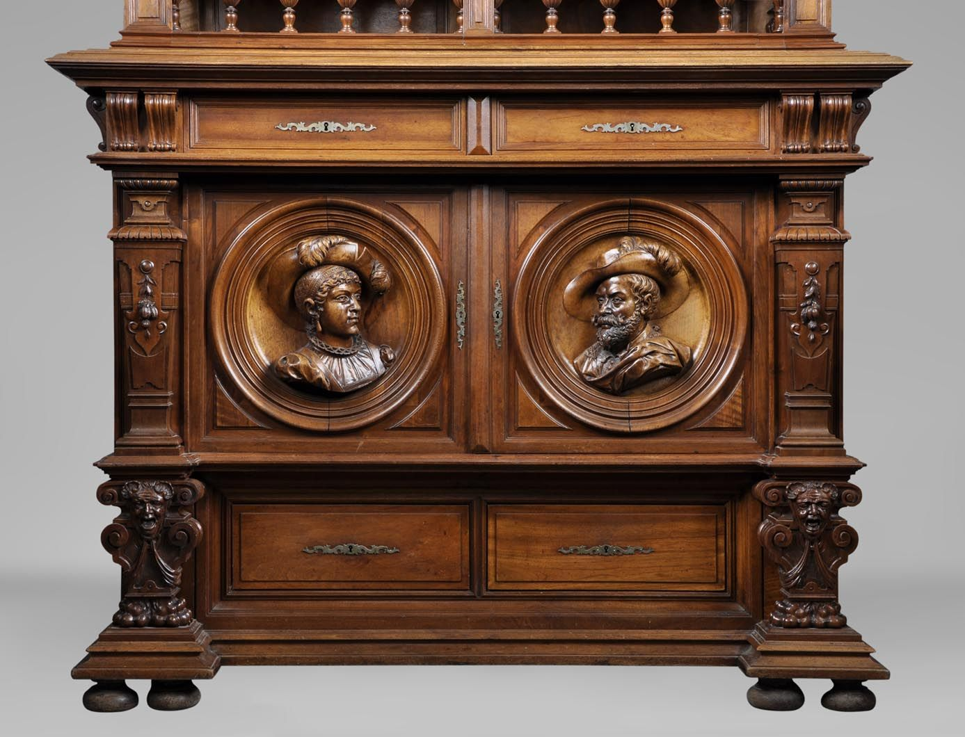 Antique Henri II style carved walnut buffet with costumed characters