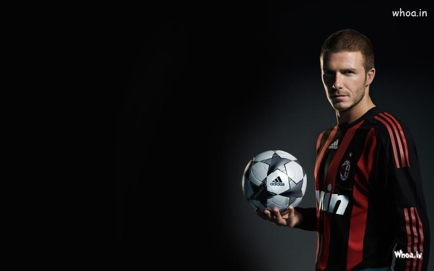 David Beckham With Adidas Football With Dark Background Wallpaper David Beckham Wallpaper Football Photography Beckham
