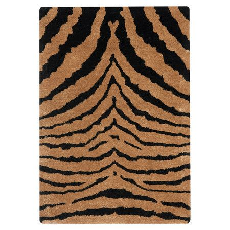 Wool rug with a tiger-print motif. Hand-tufted in India.  Product: RugConstruction Material: WoolColor: Black and brownFeatures:  Made in IndiaHand-tufted Note: Please be aware that actual colors may vary from those shown on your screen. Accent rugs may also not show the entire pattern that the corresponding area rugs have.Cleaning and Care: Professional cleaning recommended