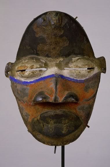 Mask Late 19th/early 20th century West Africa, Ivory Coast or Liberia Wood, metal, quills, pigment h. 21.6 cm