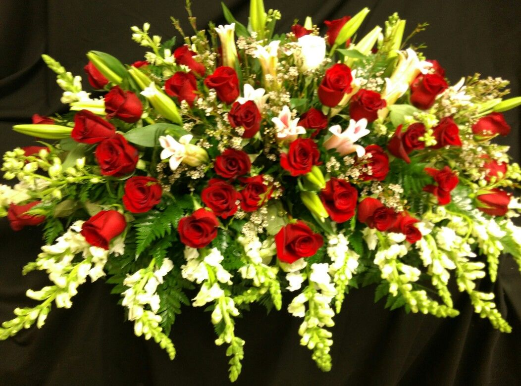 Mixed red and white snaps red roses and one white rose. Casket spray Pam Roberts