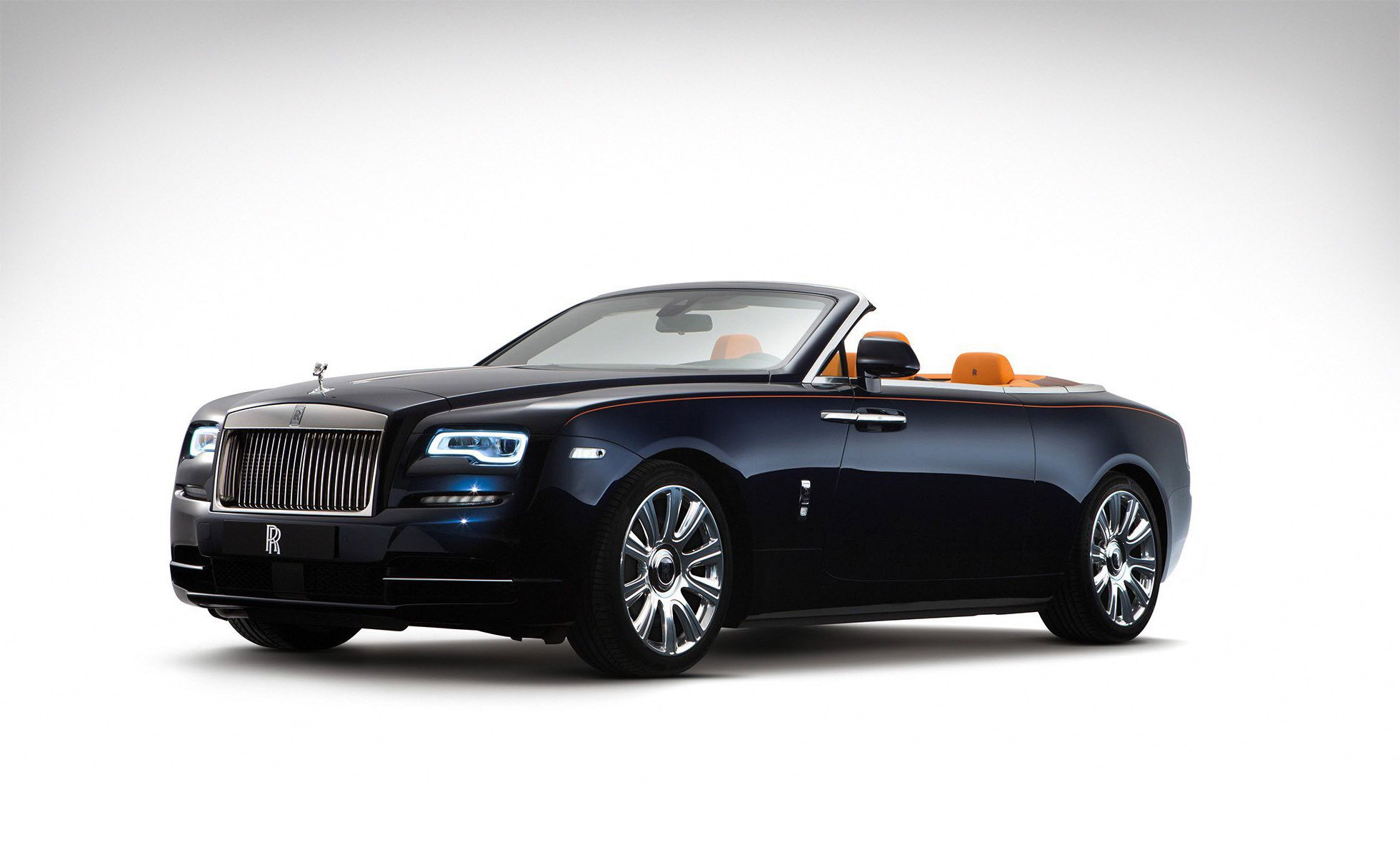 The Rolls-Royce Dawn is not entirely unlike the Ghost and Wraith in aesthetic, yet it's still different enough to stand apart and justify its own distinct name, notably thanks to its convertible design. The drophead