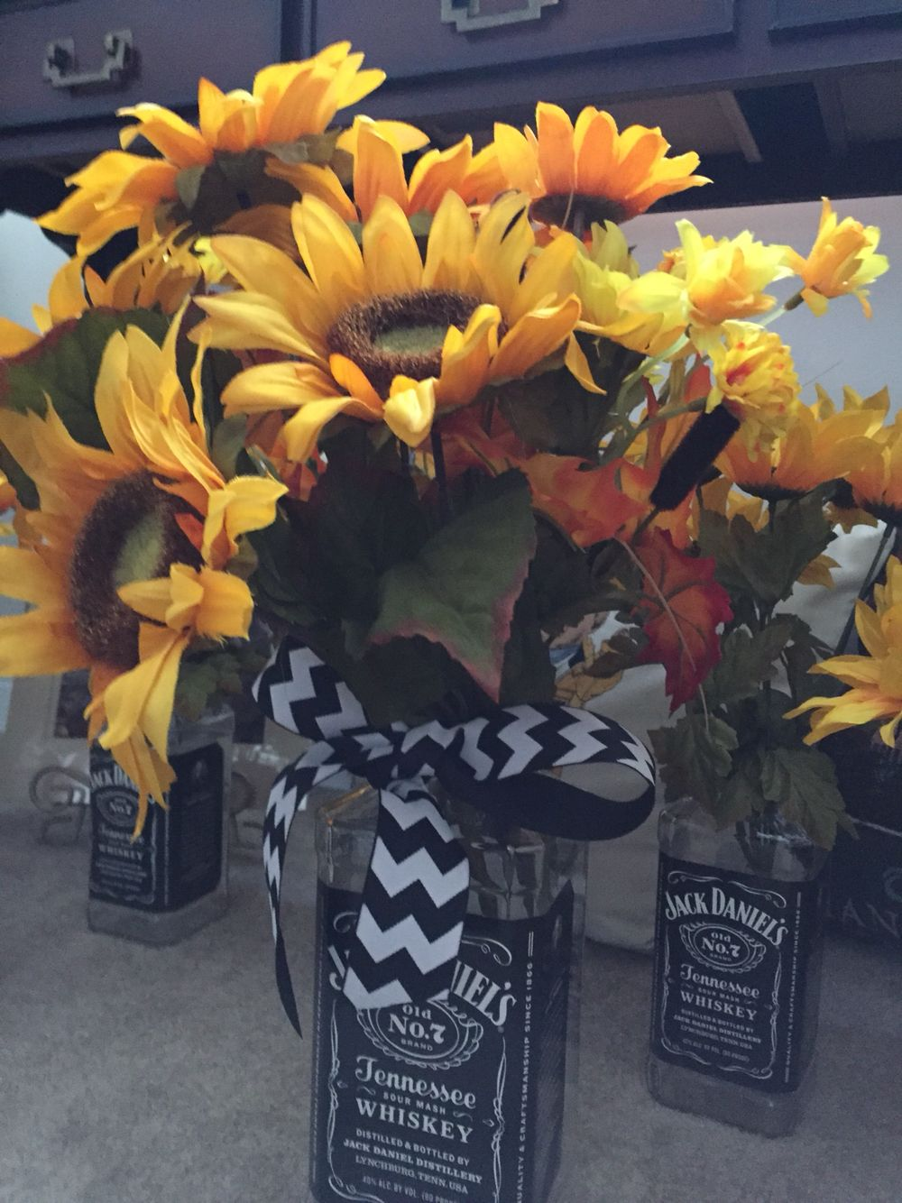 Large jack daniels bottle used for a centerpiece with