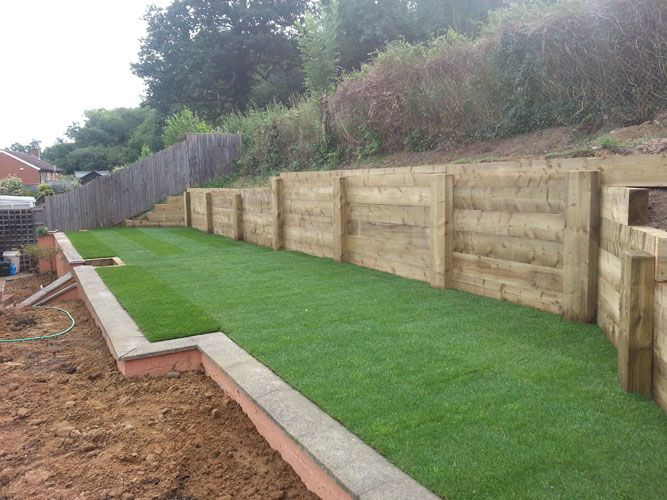 Rail sleepers wall google search new house yard ideas for Garden designs with railway sleepers