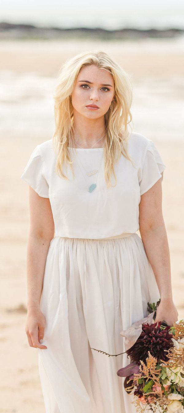Beach wedding looks  Beautiful young bridal look on the beach Separates are a really