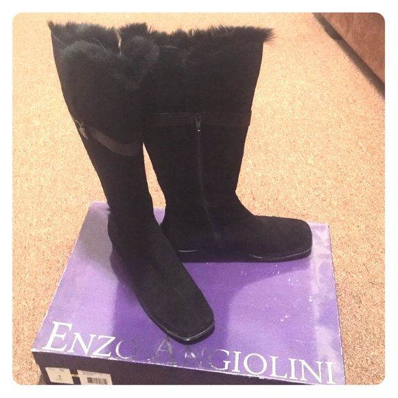 Knee high black suede boots with fur around top Cute knee high black suede boots with fur detail around top. Can turn the fur section down to get a whole different look. Like new worn once. Super comfortable! Very small heel slightly squared toe. Enzo Angiolini Shoes Winter & Rain Boots