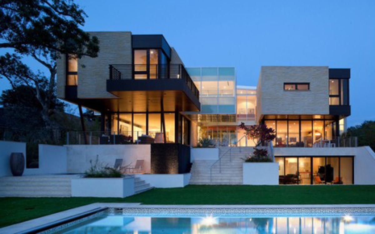 Architecture the interesting luxury modern home with big building and combination white and grey color also glass window and the swimming pool with the