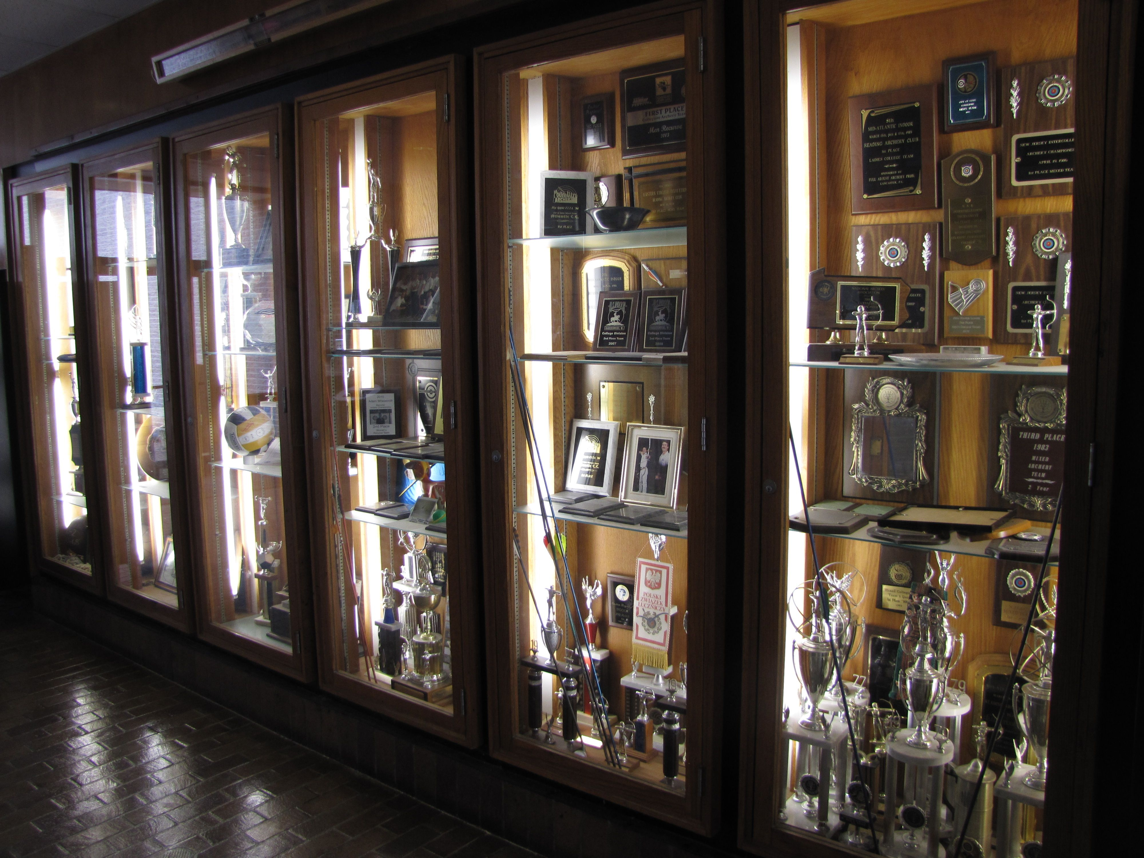 Trophy case outside of the gym  Athletics  GO BUCS in