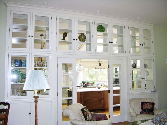a wall of windowed cabinets - Dining Room Wall Cabinets