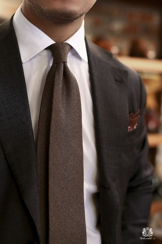 Dark grey suit, white shirt with light grey check, brown ...