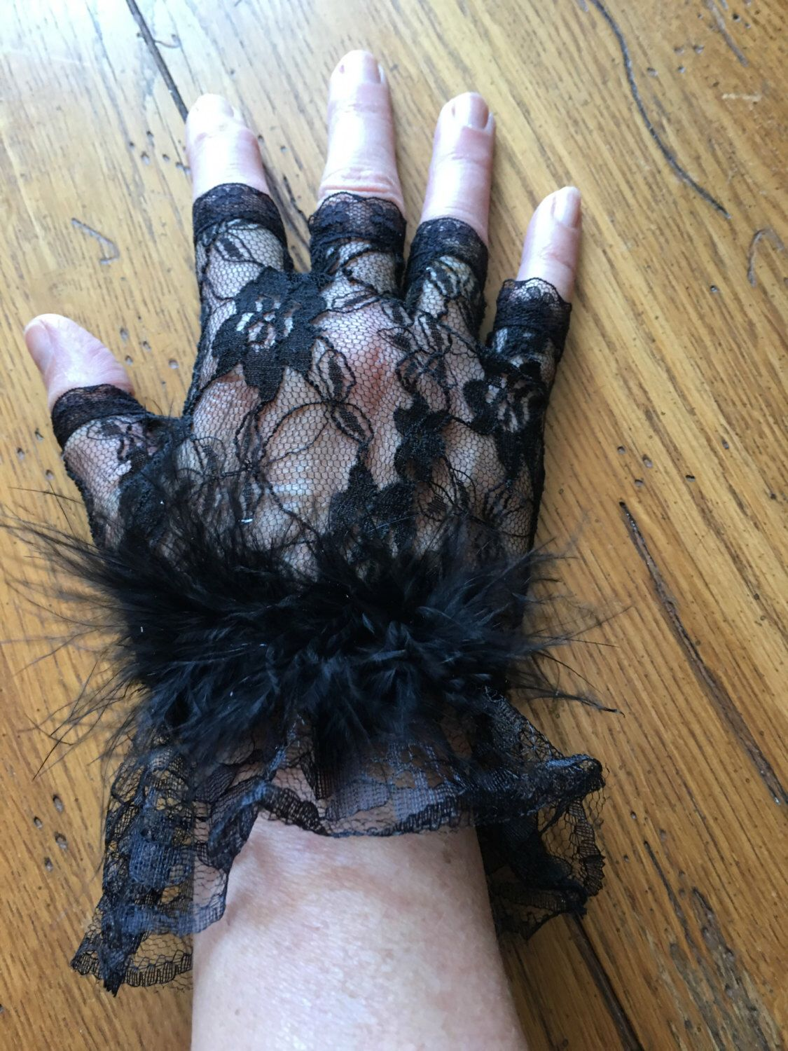 A personal favorite from my Etsy shop https://www.etsy.com/listing/291200235/short-lace-fingerless-glove-feathers-at