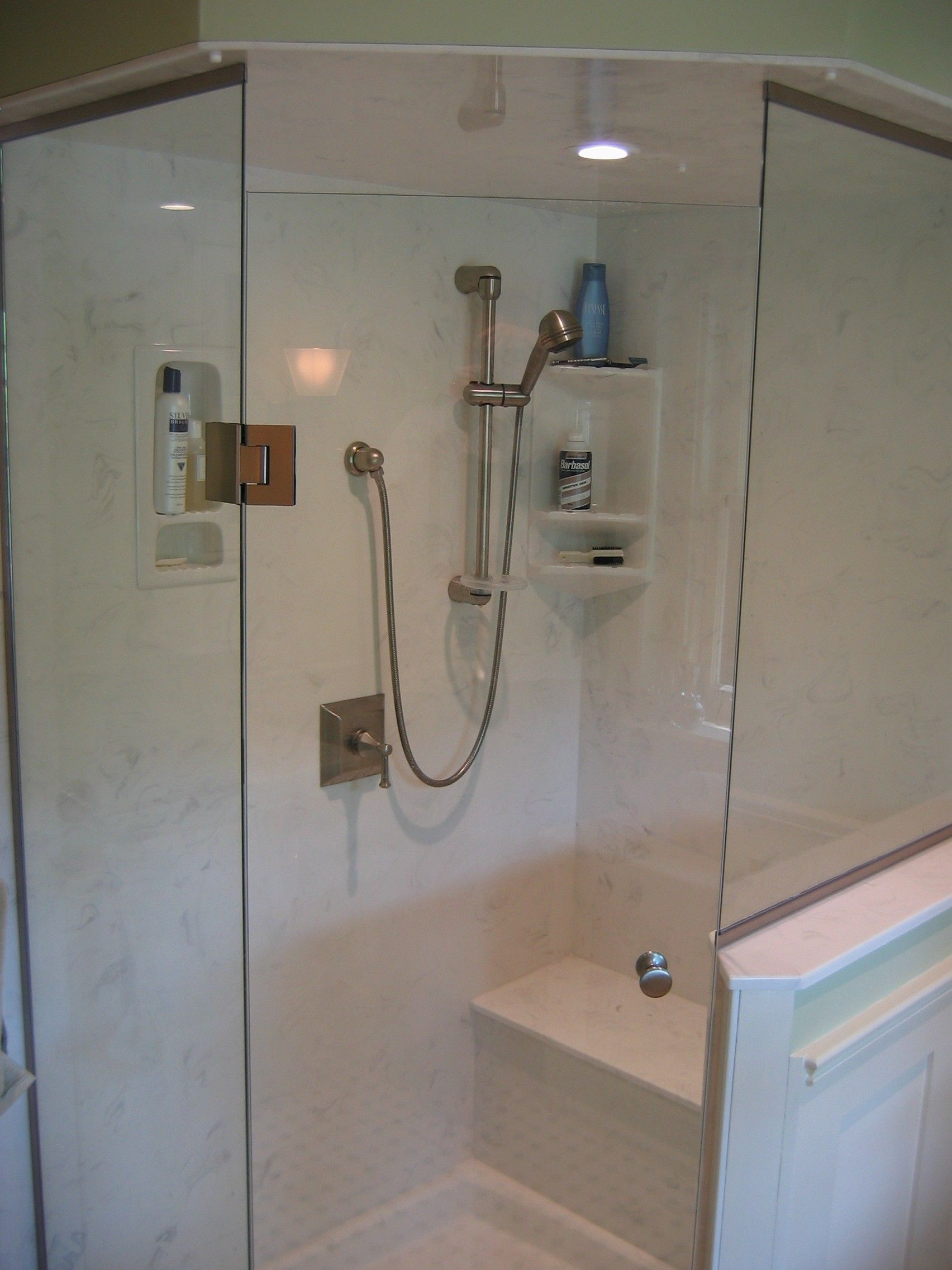 Cultured Marble And Frameless Glass Enclosure Make For A Luxurious - Composite marble shower walls