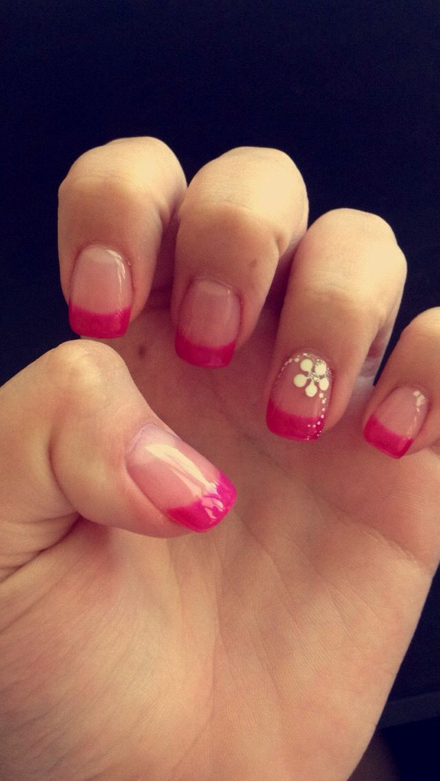 An acrylic nail with a violet/darker pink french manicure with a ...