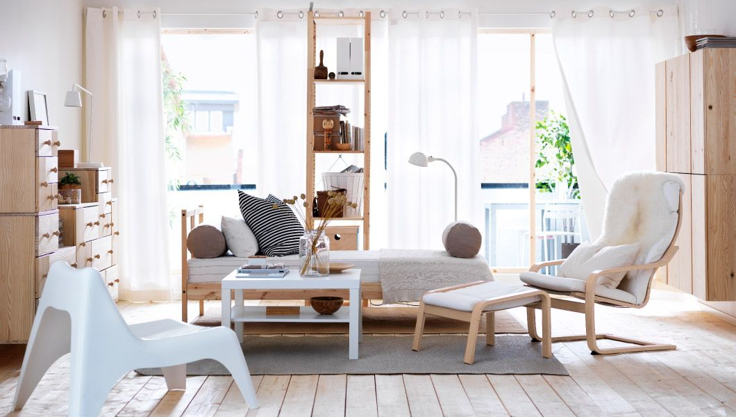 A living room full of natural pine furniture - ikea