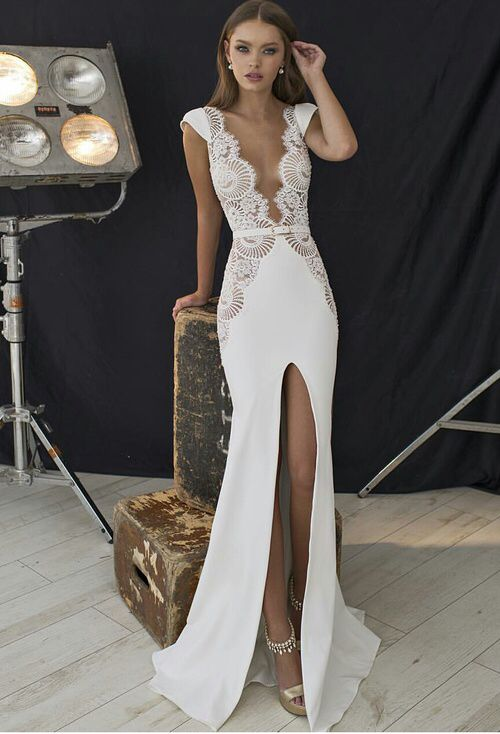 c66617ef581b August 3,2016 I love this because the dress look so classy but yet sexy by  the slit , the low v-neck and the design in sides