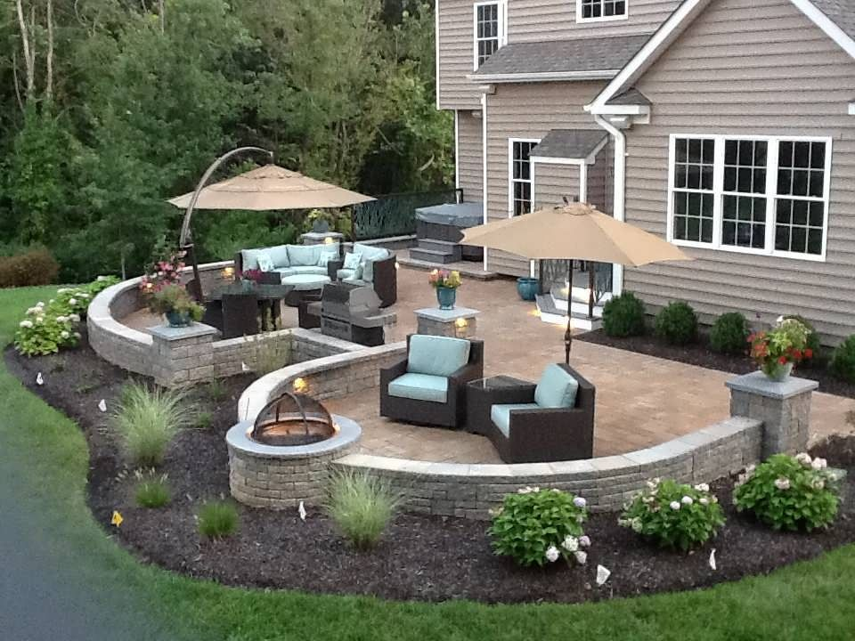 Landscape around double patio pinteres for Garden ideas for patio areas
