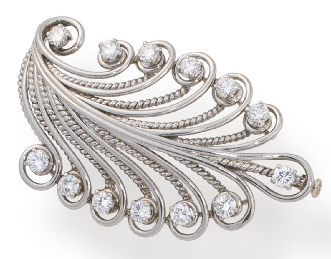 A diamond brooch, René Boivin, French, circa 1937  designed as an openwork plume detailed with round brilliant-cut diamonds; with maker's mark for René Boivin, with French assay marks, with signed box; estimated total diamond weight: 2.30 carats; mounted in platinum; length: 2in.