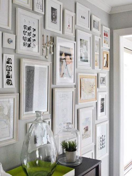 interesting gallery wall - many different sizes love the white ...
