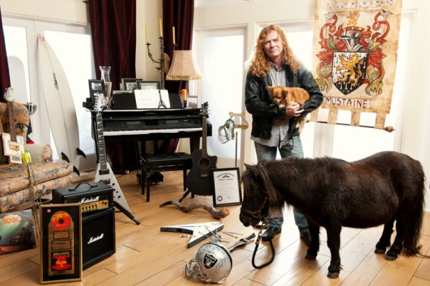 Just Megadeth's Mustaine hanging out with a mini horse